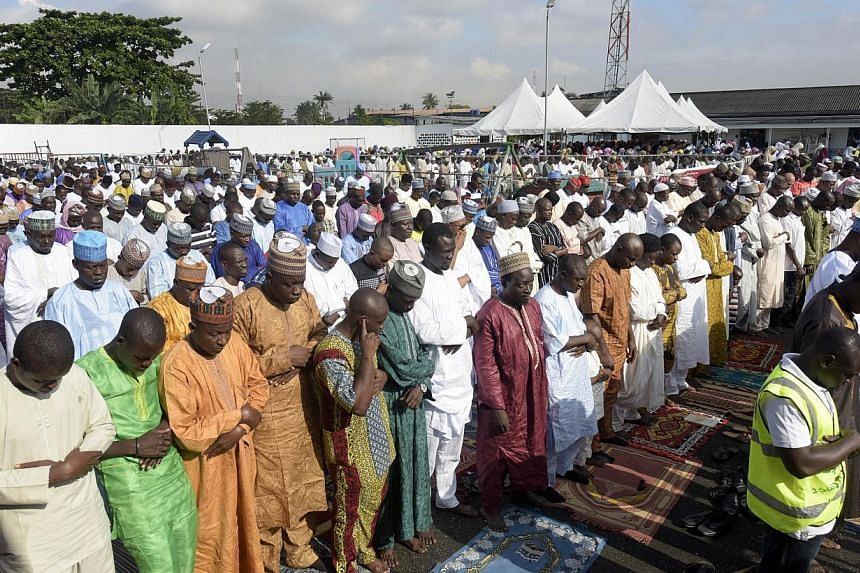 Muslim faithfuls take part in Eid Al-Adha prayer at the Syrian Mosque in Lagos on October 4, 2014. -- PHOTO: AFP