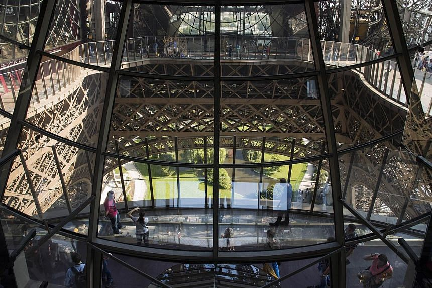 The new floor aims to turn the formerly dowdy and draughty space into as big an attraction as the viewing platform near the top of the 325-metre tower . -- PHOTO: AFP