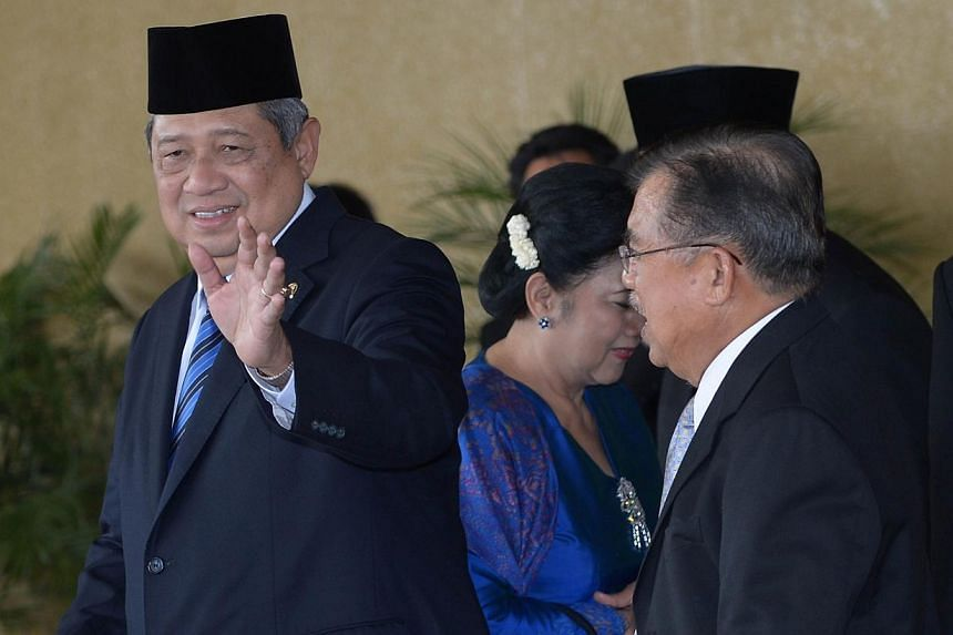 Indonesian President Susilo Bambang Yudhoyono (left) walks next to incoming vice president Jusuf Kalla (right) after an inauguration of parliament members in Jakarta on Oct 1, 2014.President Susilo Bambang Yudhoyono on Tuesday hailed the neutra