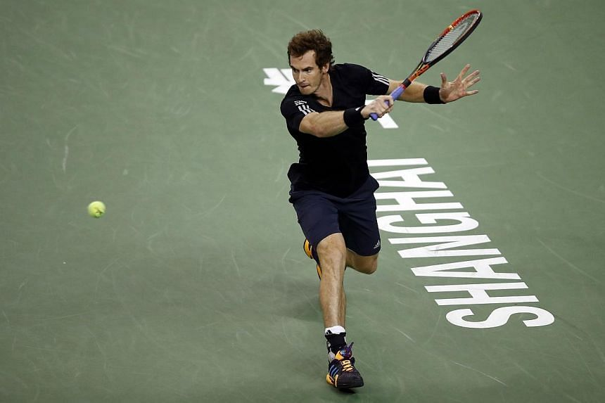 Andy Murray of Britain returns a shot during his men's singles tennis match against Teymuraz Gabashvili of Russia at the Shanghai Masters tennis tournament in Shanghai on Oct 7, 2014. Murray's bid to make the end of season ATP World Tour Finals remai
