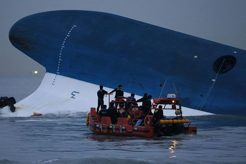 Maritime police search for missing passengers in front of the South Korean Sewol ferry which sank at sea, off Jindo on April 16, 2014.The ship's captain at the heart of South Korea's ferry disaster acknowledged during his murder trial Tuesday t