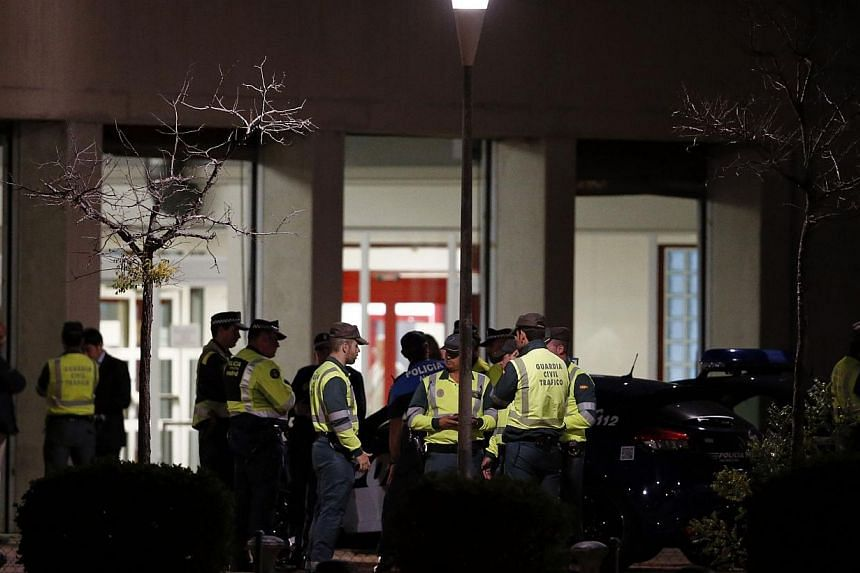 Spanish civil guards stand outside a hospital in Alcorcon, outside Madrid, where a Spanish nurse infected with Ebola was being readied for transfer to a different hospital early on Oct 7, 2014.The EU said Tuesday it has asked Spain to explain h