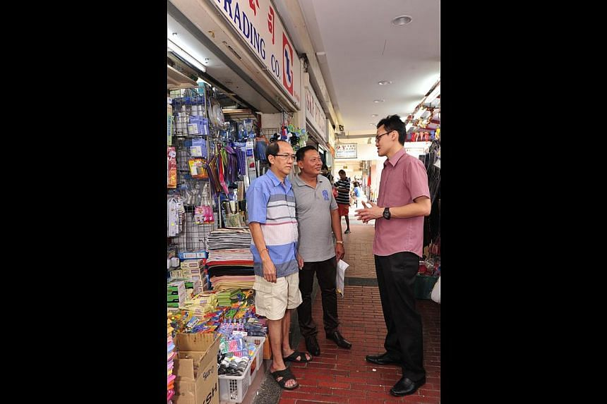Mr Tan Yian Leong (left), who owns Nam Loo Guan Trading Company in Marine Parade Central, with MPMA honorary secretary Victor Thya and Mr Dominic Lim (right), head of WeCare@Marine Parade.