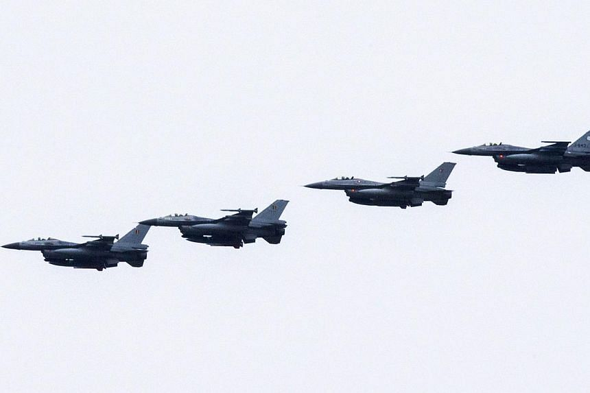 Four Dutch F-16s fly near the Leeuwarden Airbase near Leeuwarden on Sept 25, 2014.Dutch F-16s on Tuesday carried out their first strikes on the Islamic State in Iraq and Syria (ISIS) group in Iraq, the defence ministry said, with militants poss