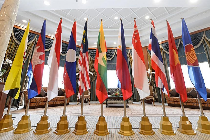 A new survey has found that 80 per cent of firms regard the Asean Economic Community (AEC) as a good business opportunity and believe it will accelerate growth in their industries. -- PHOTO: ST FILE