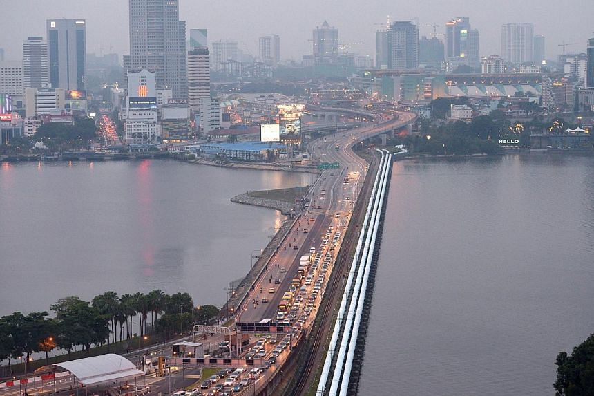 The impact of the Causeway toll hikes on economic activity in Singapore is likely to be small, as land transport takes up a small portion of business costs, Minister of State (Trade and Industry) Teo Ser Luck said on Tuesday. -- PHOTO: ST FILE