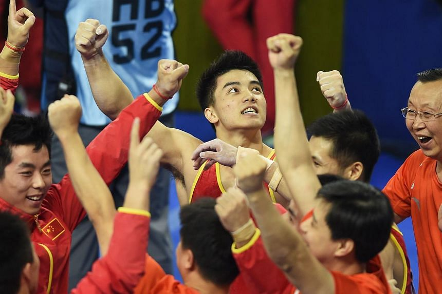 Hosts China won a record sixth straight world men's gymnastics team title on Tuesday night, with their final performer overturning the lead set by arch-rivals Japan at the last moment. -- PHOTO: AFP