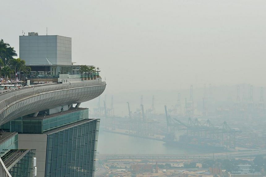 Air quality in Singapore improved on Tuesday morning following a hazy day on Monday when air quality deteriorated to its worst levels this year. -- ST PHOTO:CAROLINE CHIA
