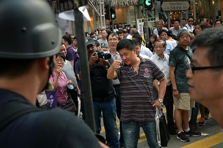 A man opposed to the protests taunts the demonstrators at Mong Kok in Kowloon on Oct 6, 2014. -- ST PHOTO: KUA CHEE SIONG