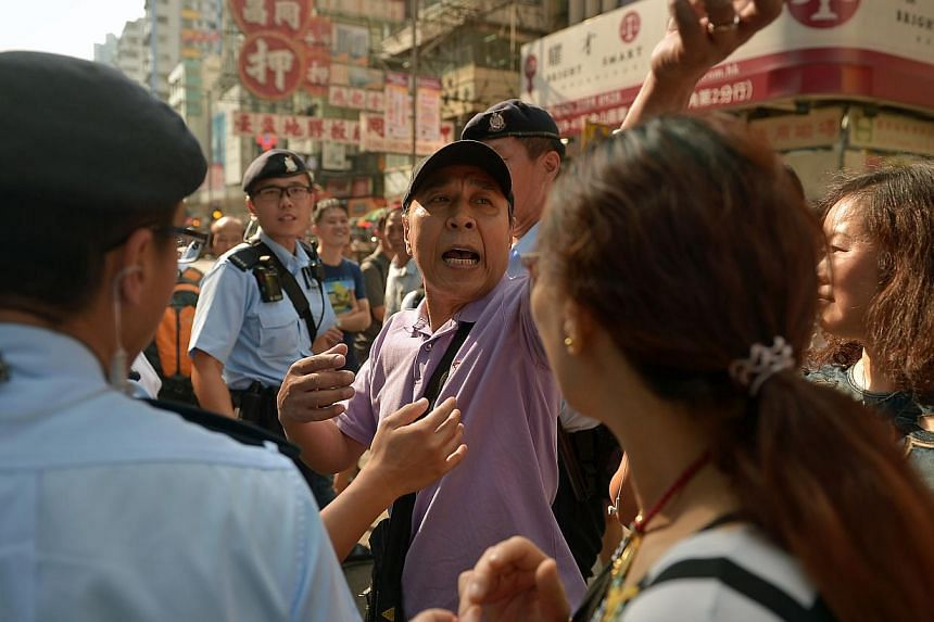 An man opposed to the protests taunts the demonstrators at Mong Kok in Kowloon on Oct 6, 2014. Although the mood is generally calm, there are still little pockets of arguments happening in Mong Kok. -- ST PHOTO: KUA CHEE SIONG