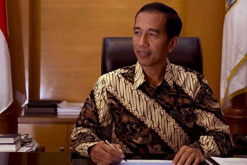 Soon after he became governor of Indonesia's traffic-clogged capital in 2012, Joko Widodo came up with a creative approach to an impasse blocking completion of a ring-road around Jakarta for almost a decade. -- PHOTO: AFP