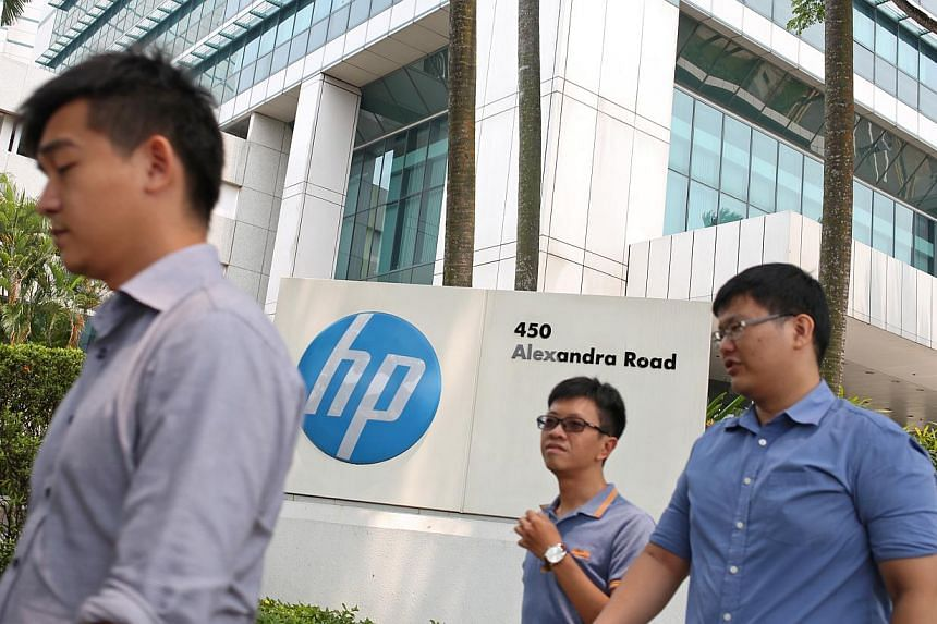 News of Hewlett-Packard's decision to split into two listed companies has left Singaporean employees of the company concerned if the break-up would spell job cuts from the US tech giant's operations here. -- ST PHOTO:EDWARD TEO FOR THE STRAITS