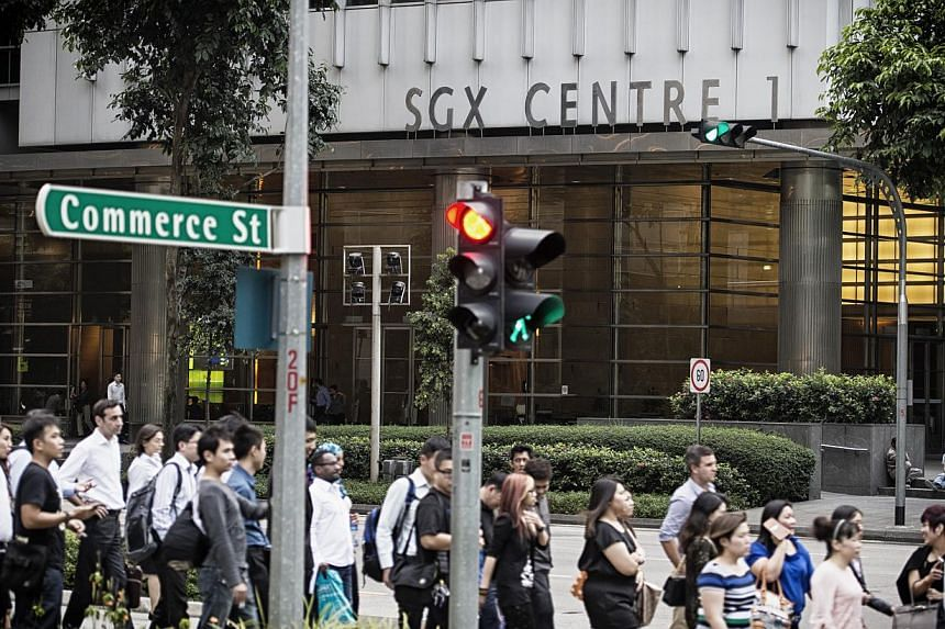 Shares fell after a return to trade following Monday's break for a public holiday, with the Straits Times Index ending the day down by 9.25 points or 0.28 per cent at 3,243.99. -- PHOTO: BLOOMBERG