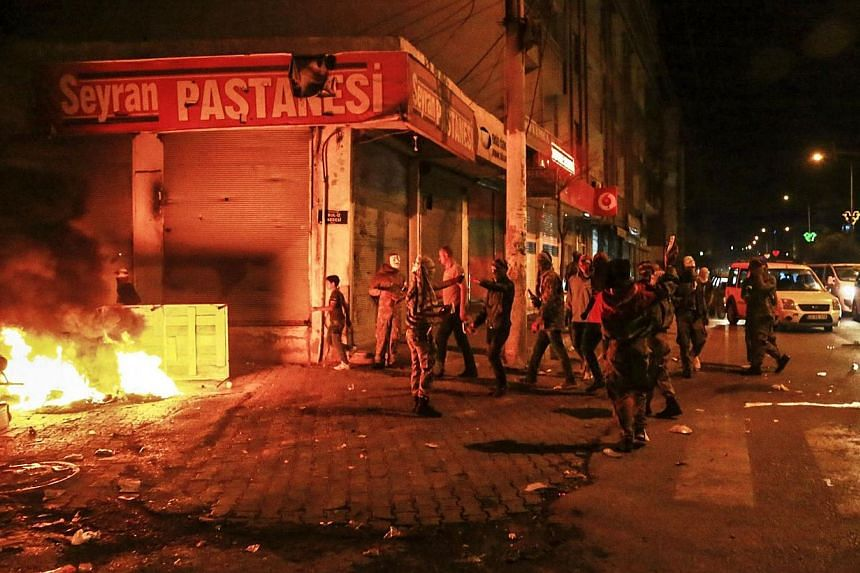 Kurdish protesters are pictured in a street on Oct 7, 2014 in the southeastern city of Diyarbakir during a demonstration to demand more western intervention against Islamic State militants (IS) in Syria and Iraq. -- PHOTO: AFP