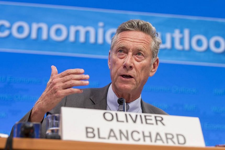 This IMF photo shows International Monetary Fund Economic Counsellor and Director of the Research Department Olivier Blanchard as he speaks on a panel to discuss World Economic Outlook at the first press briefing of the 2014 IMF/World Bank Annual Mee