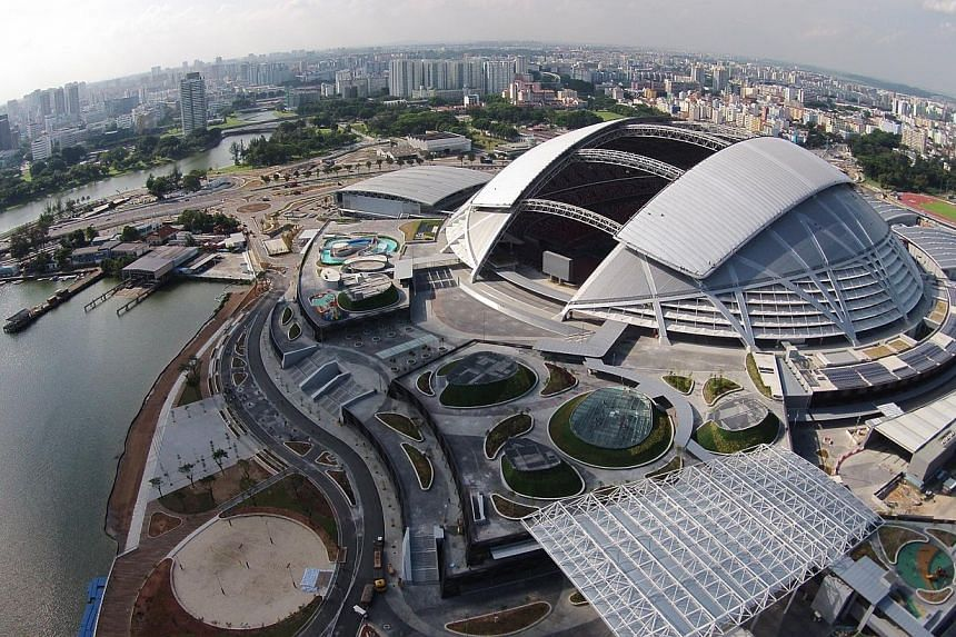 The new National Stadium in Kallang has a major role to play in hosting premier competitions and glamour friendlies as part of the International Rugby Board's (IRB) push to grow the sport across Asia. -- ST PHOTO: DESMOND LIM