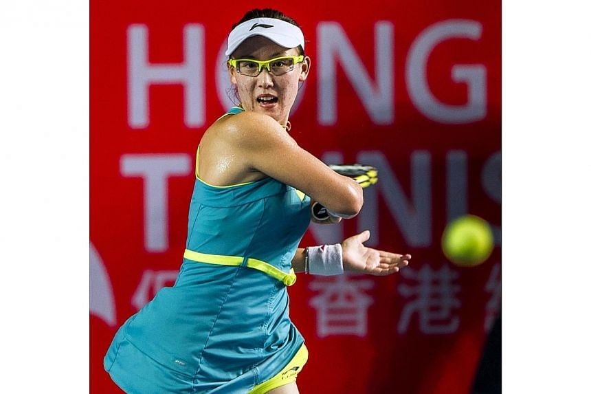 China's Zheng Saisai returns the ball to Germany's Sabine Lisicki during their women's quarter final singles tennis match at the Hong Kong Open on Sept 12, 2014. -- PHOTO: AFP