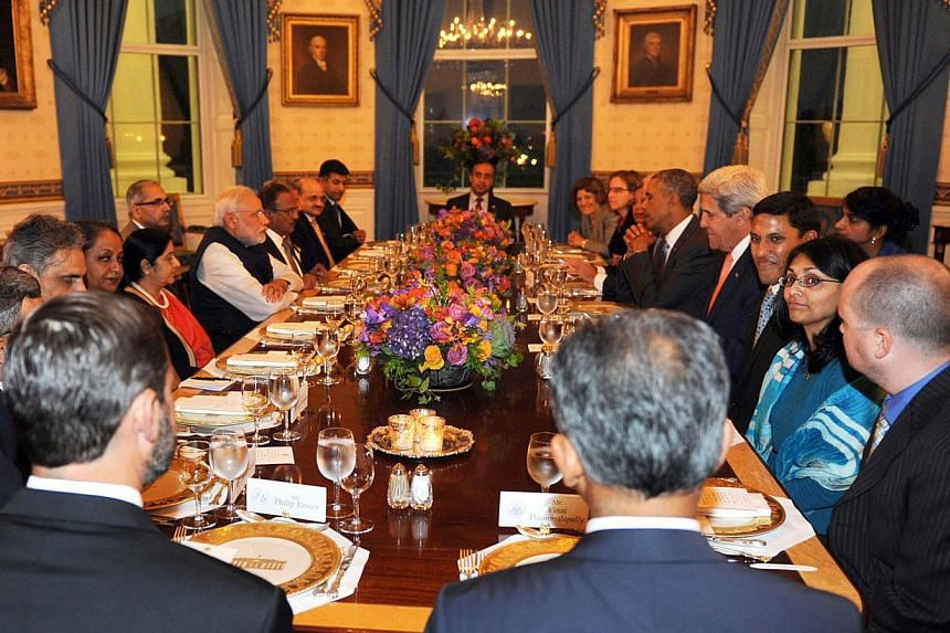 In this photograph released by the Indian Press Information Bureau (PIB) on Sept 30, 2014, Indian Prime Minister Narendra Modi (centre, left middle section of table) sits across from US President Barack Obama with Indian and US dignitaries, including