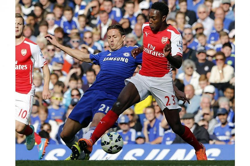 Chelsea's Nemanja Matic (left) challenges Arsenal's Danny Welbeck during their English Premier League soccer match at Stamford Bridge in London on Oct 5, 2014.English Premier League clubs have discussed playing a regular season round of 10 matc
