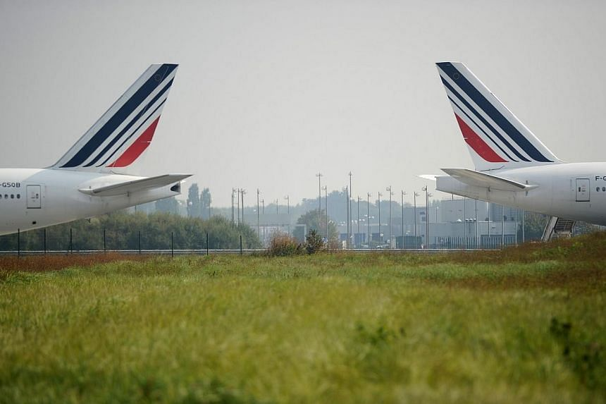 Struggling French flag carrier Air France on Wednesday said last month's two-week strike would have an impact of around 500 million euros (S$808 million) on its bottom line for this year. -- PHOTO: AFP