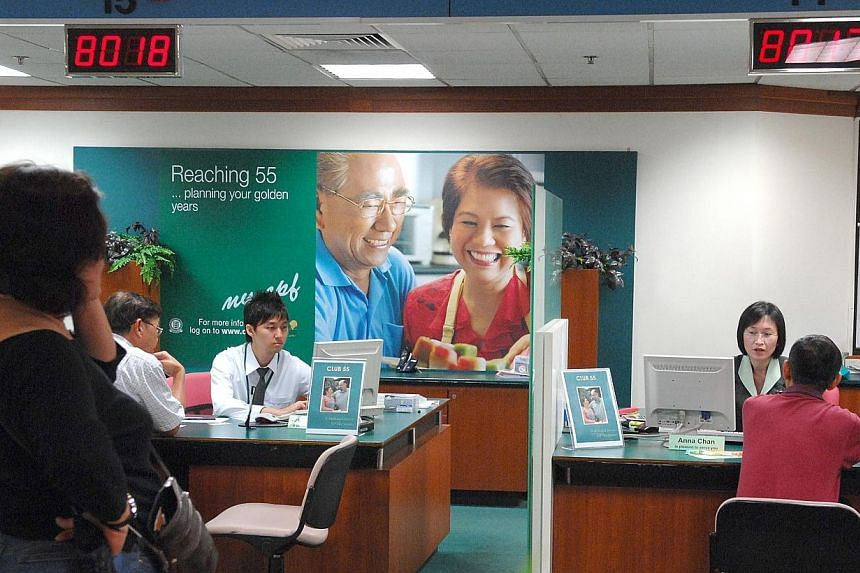 CPF members queueing at CPF Inquiry Counters at the CPF Building. -- PHOTO: ST FILE