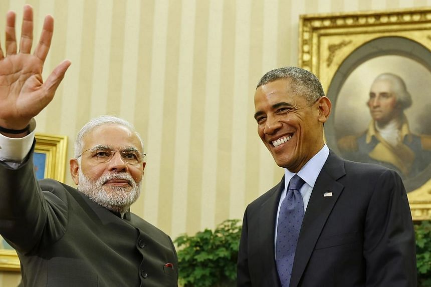 US President Barack Obama smiles as he hosts a meeting with India's Prime Minister Narendra Modi in the Oval Office of the White House in Washington on Sept 30, 2014.-- PHOTO: REUTERS