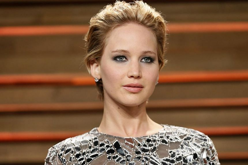 Actress Jennifer Lawrence arrives at the 2014 Vanity Fair Oscars Party in West Hollywood, California on March 2, 2014. -- PHOTO: REUTERS