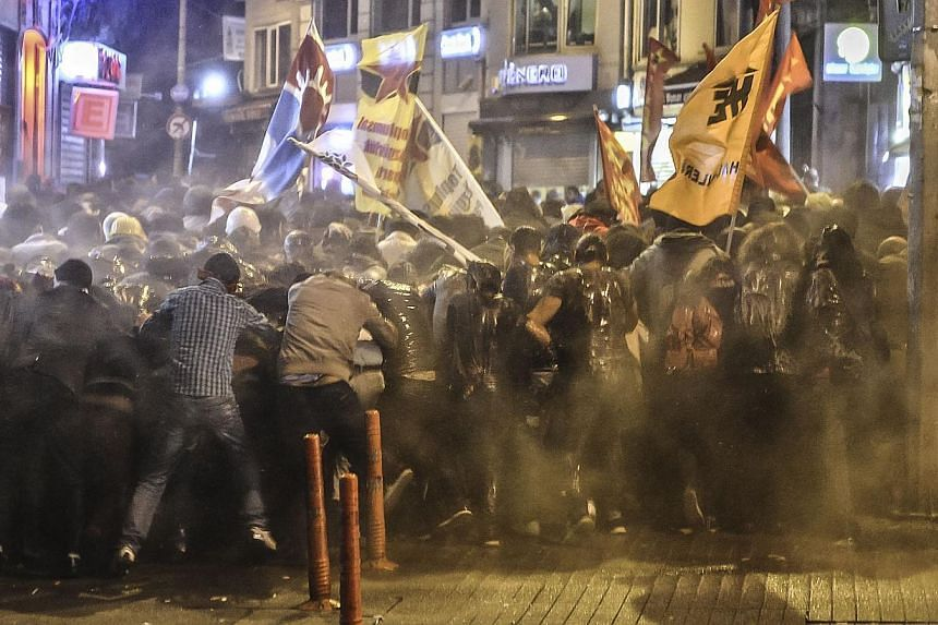 Police used tear gas and water cannon on Oct 7, 2014 in Istanbul against demonstrators who protest against attacks launched by Islamic State insurgents targeting the Syrian city of Kobane and lack of action by the government. -- PHOTO: AFP