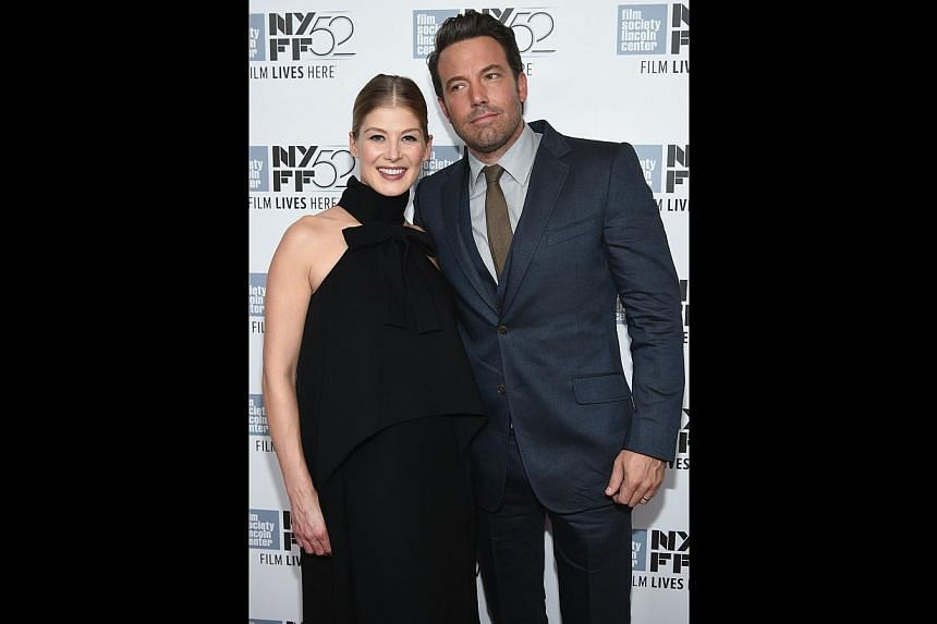 Stars of Gone Girl, Rosamund Pike and Ben Affleck, at the world premiere of the movie in New York last month.