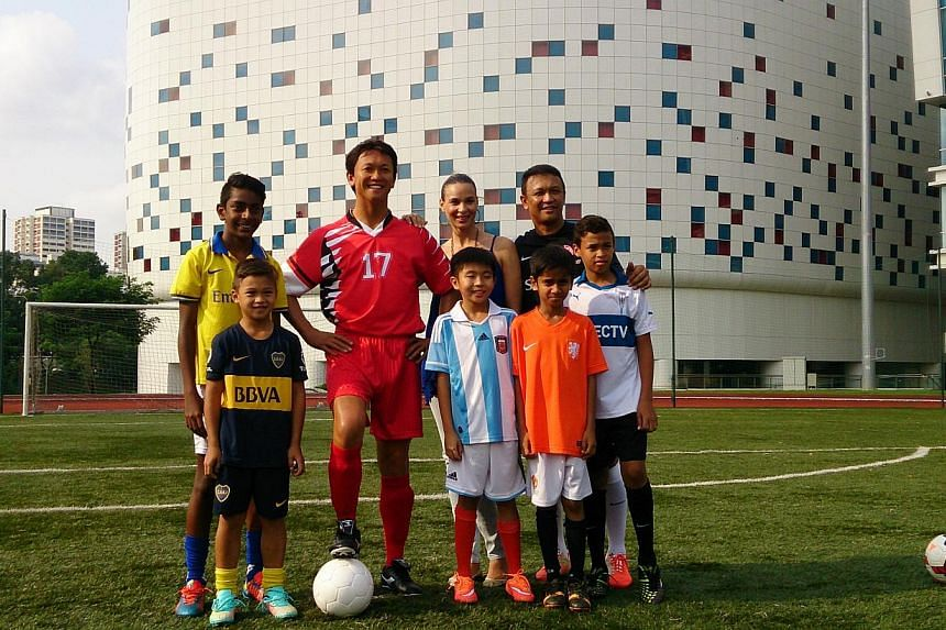 Local footballing legend Fandi Ahmad has been immortalised in wax after he was inducted into the sporting hall of fame at Madame Tussauds' Singapore museum in Sentosa. In the picture are (front row, from left)Iryan Fandi Ahmad, 8, Kieran Jordan