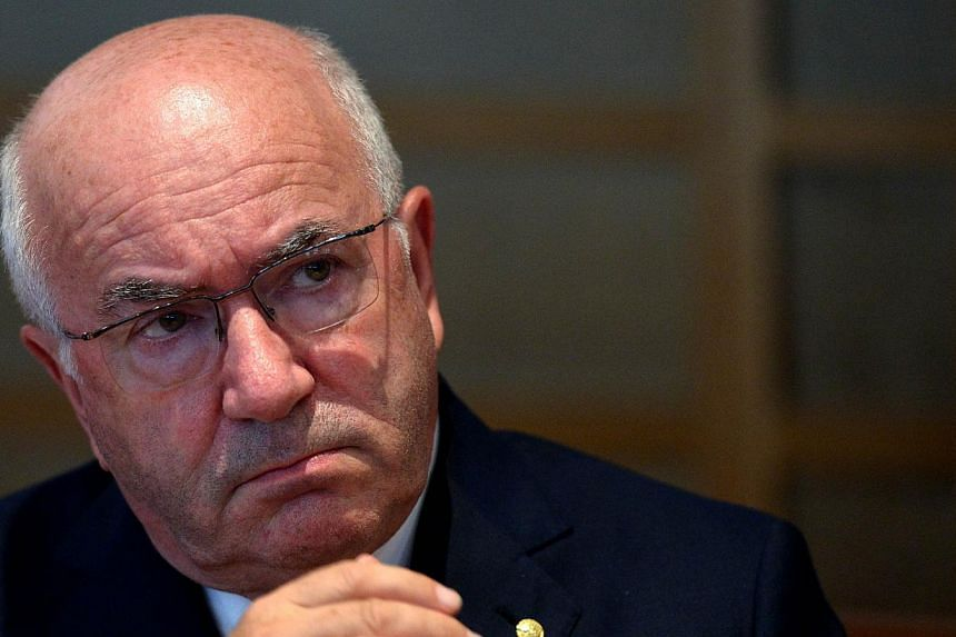 Uefa on Tuesday banned Italian Football Federation boss Carlo Tavecchio for six months and ordered him to hold an anti-racism event in punishment for widely condemned remarks. -- PHOTO: AFP