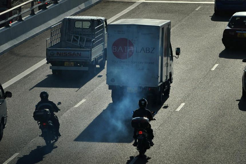 A lorry emitting clouds of white smoke on the Pan-Island Expressway (PIE). -- PHOTO: ST FILE