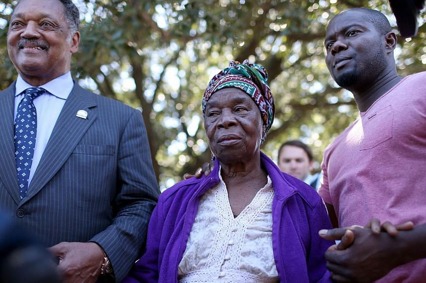 Rev. Jesse Jackson (L) stands with Nowai korkoyah (C) the mother of Ebola patient Thomas Eric Duncan, as well as his nephew, Josephus Weeks, after they spoke to the media at the Texas Health Presbyterian hospital on October 7, 2014 in Dallas, Texas.