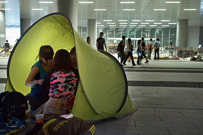 Protesters camp outside the Legislative Office in Admiralty, Hong Kong on Tuesday night. -- ST PHOTO: KUA CHEE SIONG
