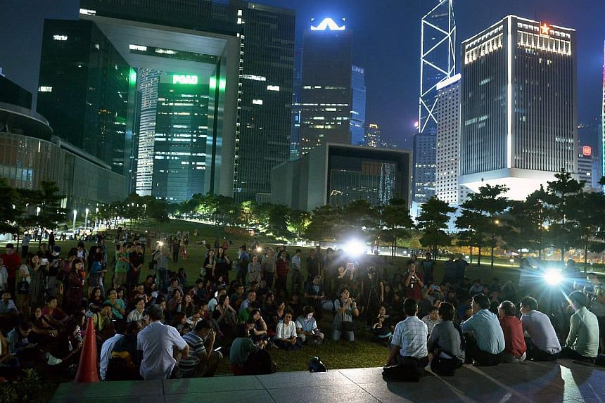 Protesters sit in Tamar Park next to the Legislative Office in Admiraty, Hong Kong sharing views on the protests and politics on Oct 7, 2014. -- ST PHOTO: KUA CHEE SIONG