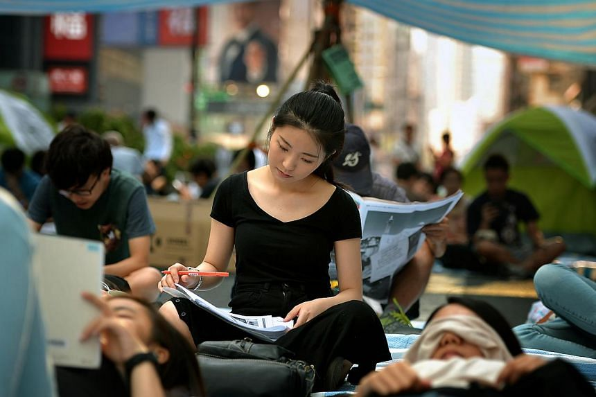 A student doing school work in the protest site in Mong Kok on Oct 7, 2014. -- ST PHOTO: KUA CHEE SIONG