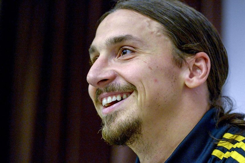 Sweden soccer captain Zlatan Ibrahimovic smiles during a news conference at the Scandic Park Hotel in Stockholm on Oct 7, 2014. -- PHOTO: REUTERS