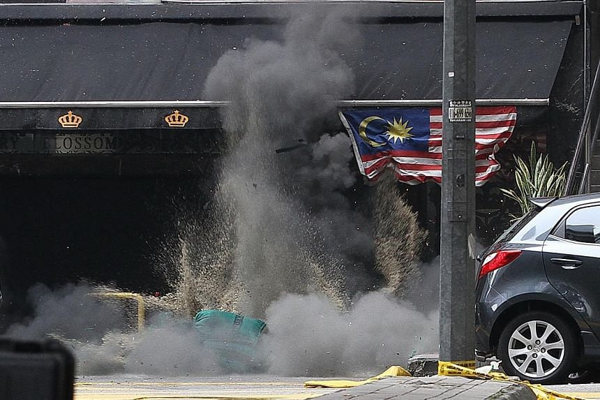 The Singaporean who was among the 13 people injured by a rare grenade blast early Thursday morning is well, but said he is in the dark about what triggered the attack in downtown Kuala Lumpur. -- PHOTO: CHINA PRESS