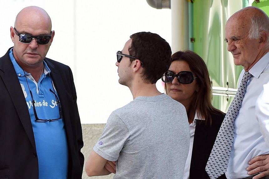 Manager of injured Marussia driver Jules Bianchi of France, Nicolas Todt (2nd left) speaks with Philippe (left) and Christine (2nd right) Bianchi, parents of Jules and president of the FIA Medical Commission Gerard Saillant (right) at the Mie General