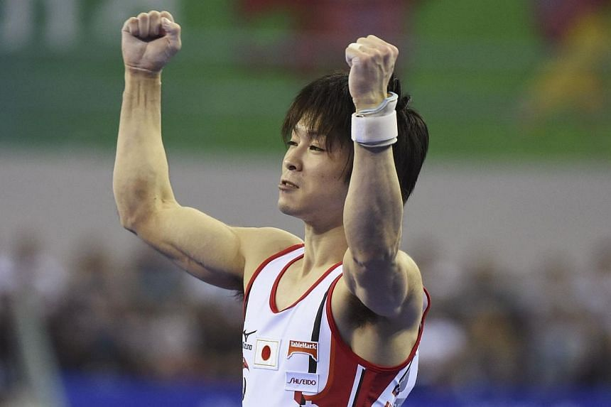 Kohei Uchimura of Japan celebrates in the Men's Team Final during the 2014 World Artistic Gymnastics Championships in Nanning, Oct 7, 2014.Japan's Kohei Uchimura won a record-stretching fifth straight all-around title at the world gymnastics ch