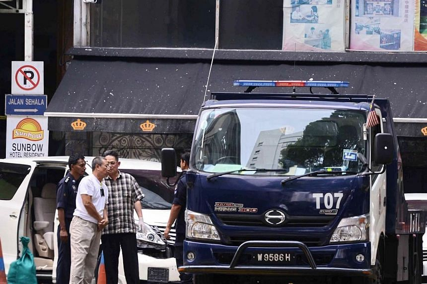Forensic teams arrive at the scene to investigate after a grenade exploded in front of the Sun Complex in Jalan Bukit Bintang, Kuala Lumpur on Oct 9, 2014. -- PHOTO: AFP