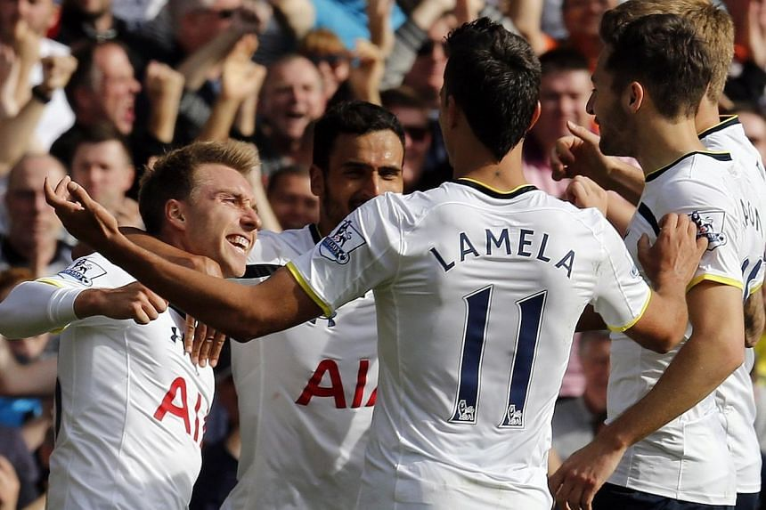 Tottenham Hotspur's Christian Eriksen (left) celebrates after scoring the opening goal during their English Premier League soccer match against Southampton at White Hart Lane in London, England on Oct 5, 2014. Uefa general secretary Gianni Infan