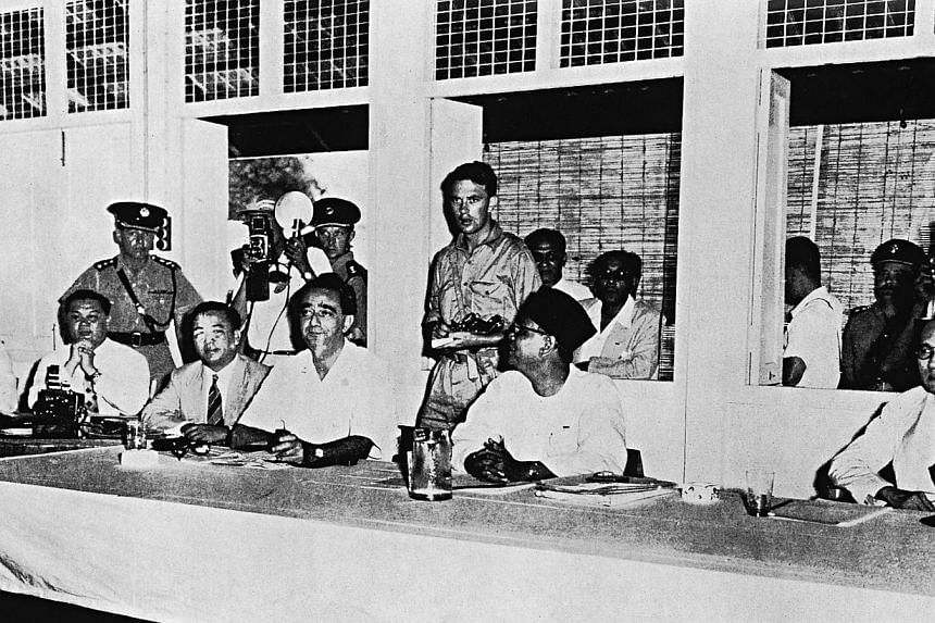 Tengku Abdul Rahman (second from right, seated), the Chief Minister of the Federation of Malaya, Mr David Marshall (to his left), then the Chief Minister of Singapore, and the late Dato Tan Cheng Lock (right) sit facing the Communist delegates led by