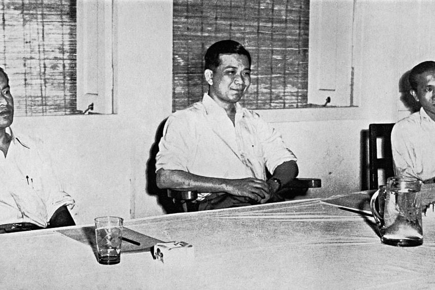 Chin Peng (centre), Chen Tien (right) and Abdul Rashid Mahideen, the Communist delegates who had emerged from the jungle, sit at the negotiating table at the Baling Talks, facing the Tengku. The talks ended in failure when Chin Peng refused to lay do