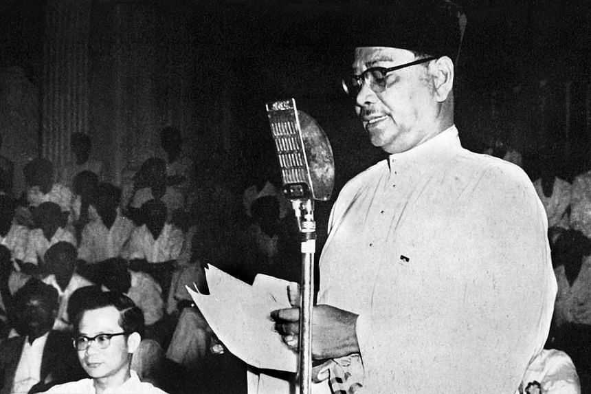 Tengku Abdul Rahman, as President of Umno and fraternal delegate to the inaugural meeting of the PAP on Nov 21, 1954, addresses the gathering, expressing his good wishes for the success of the new party. He said that if there were more people like th