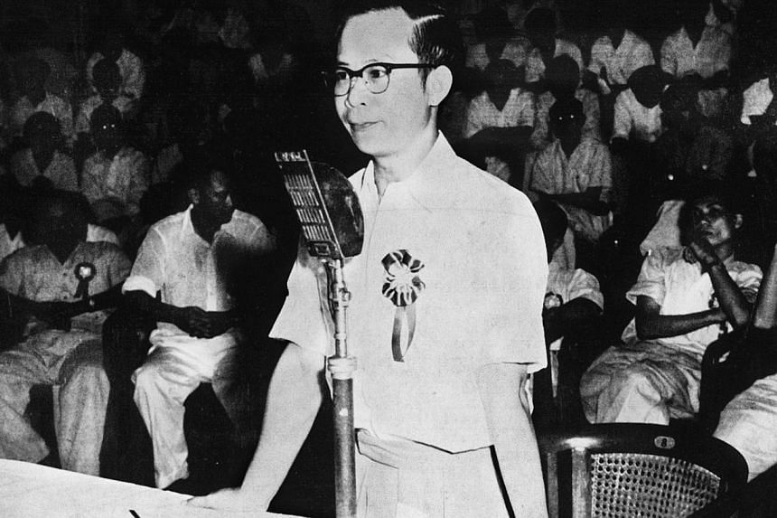 Dr Toh Chin Chye addresses the inaugural meeting of the PAP held at the Victoria Memorial Hall on Nov 21, 1954. He had just been appointed pro-tem chairman of the party when he rose to speak. -- PHOTO: ST PRESS
