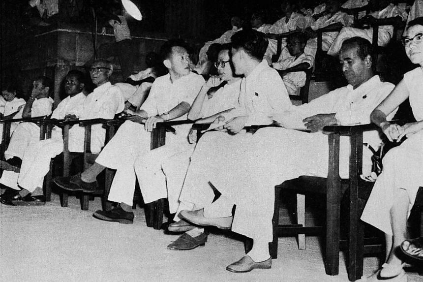 The PAP leaders seated on a platform at the Padang where about 50,000 people gathered on June 3, 1959 to cheer the victory of the PAP in the general election. -- PHOTO: ST PRESS