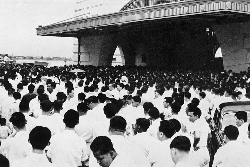 Lee Kuan Yew speaking at a lunch-time election rally held at Clifford Pier on May 26, 1959, where he explained that the ultimate contestants in the battle for democracy would be the PAP and the Communists. -- PHOTO: ST PRESS