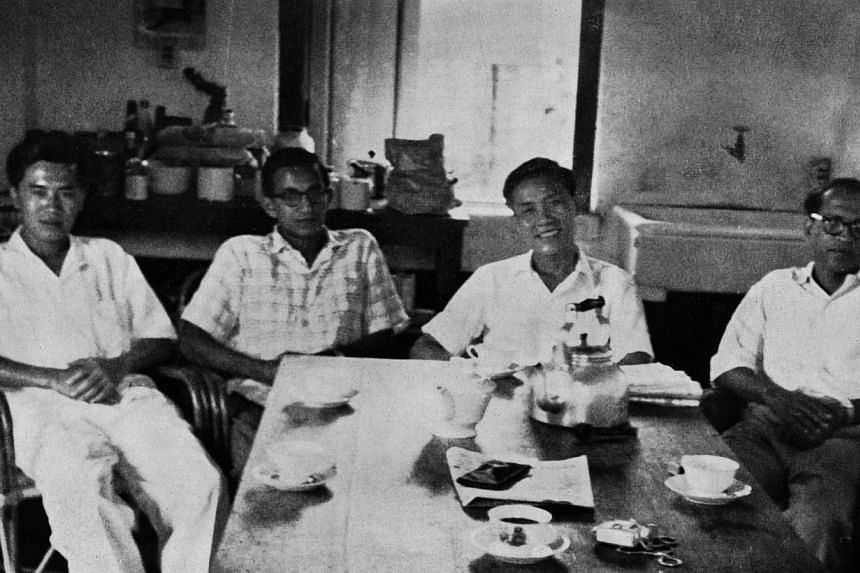 (From left) Lim Chin Siong, S. Woodhull, Fong Swee Suan and Devan Nair at the St John's Island detention camp on Chinese New Year's Day, February 1959. The picture was taken by Lee Kuan Yew when he paid them a New Year's Day visit. -- PHOTO: ST PRESS