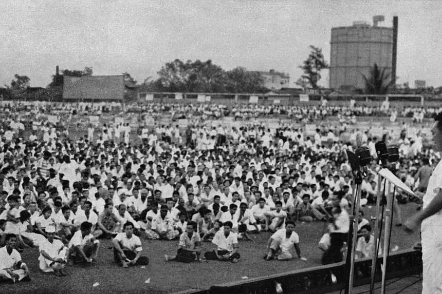 Prime Minister Lee Kuan Yew addresses the 1961 May Day Rally at the Jalan Besar Stadium. On this occasion he made it clear that the PAP government would not permit itself to be made use of by the British or by the Communists for their own selfish end